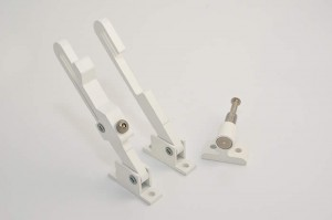 Tilt restrictor a piece of functional vertical slider hardware