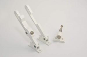 Tilt restrictor a piece of functional vertical slider hardware